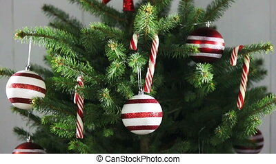 Decorated Christmas tree with candy canes , star , striped ...