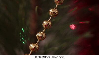 decorated christmas tree with flashing garlands macro