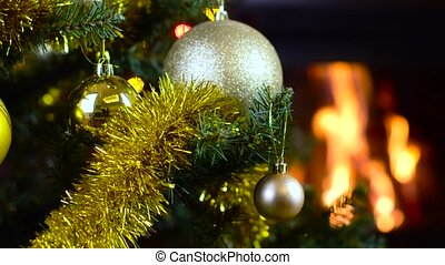 decorated christmas tree with lights in front of fireplace