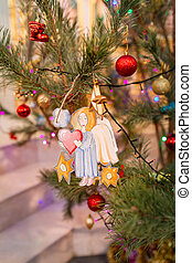 Decorated Christmas tree with toy angel in Orthodox church