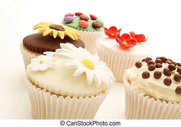 decorated cup cakes on white background