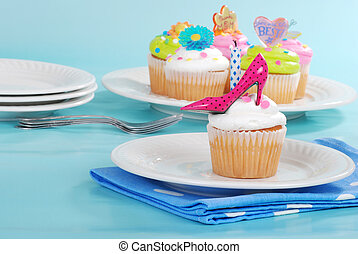 decorated cupcakes on a plate