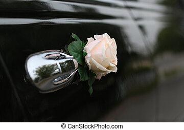 Decorated door of the wedding limousine