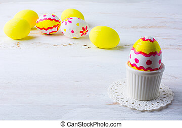 Decorated Easter egg in an egg cup