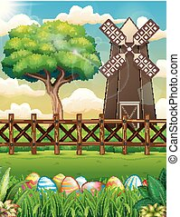 Decorated Easter eggs on the grass with a farm background
