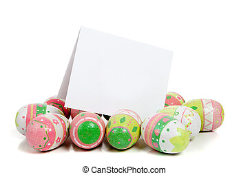 Decorated easter eggs on white with a blank notecard