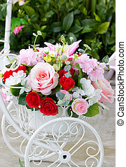 Decorated Flowers Bunch In White Cart On The Floor.