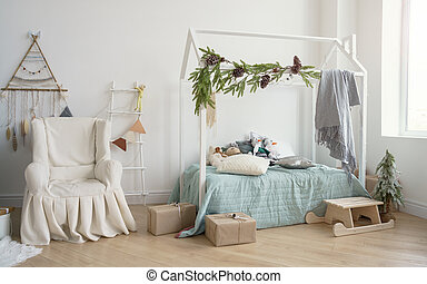 Decorated Kids bedroom with covered armchair and house shape bed