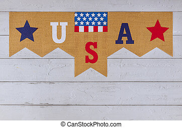 Decorated letter USA sign with patriotism federal holiday of Labor Day Memorial Day of the American flag on old wood background