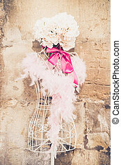 Decorated mannequin near grunge wall