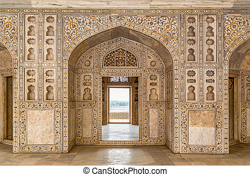 Agra Fort - Decorated marble wall frames gate and door at...