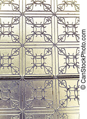 decorated metal fence in front of a window
