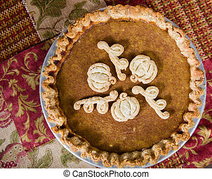 Decorated pumpkin pie with dough