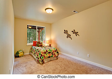 Simple room for kids with single bed, toys and decorated wall