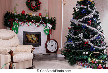 Decorated room with Christmas tree and fireplace