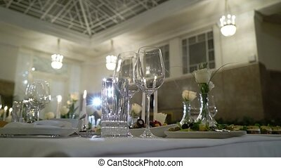 Decorated table on a gala dinner party or wedding celebration steadicam