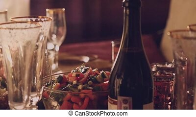 Decorated table with Glass of wine with food on table in slowmotion. 1920x1080