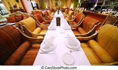 Decorated tables stand in center of lounge of east restaurant