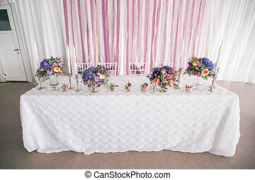 decorated Wedding table setting with candles