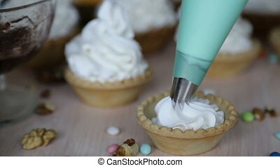 Decorating cake basket with protein cream (meringue) using ...
