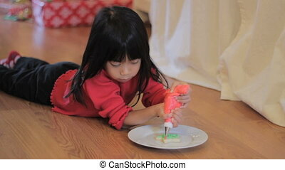 Decorating Christmas Cookie Red - A cute little 5 year old...