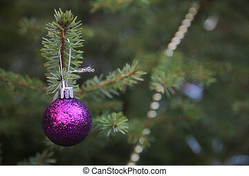 Decorating Christmas tree on green background