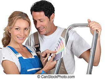 Decorating couple with color chart and steps