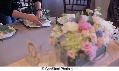 Decorating napkins on the wedding at cloudy day