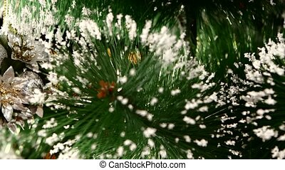 Decoration - a round toy like flowers on christmas tree, bokeh, light, black, garland, cam moves to the left