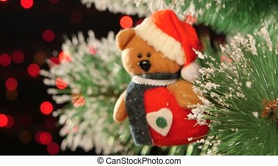 Decoration - a toy teddy bear on christmas tree, bokeh, light, black, garland, cam moves to the left