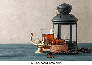 Decoration and food of Ramadan Kareem holiday on wooden...