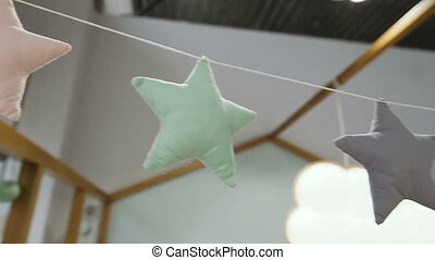 Decoration. Asterisks hung on the ceiling