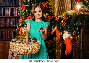 decoration - Cute seven year old girl stands with a gift by...