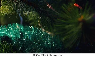 Decoration for Christmas tree - a gold bump. The celebration of Christmas and New Year