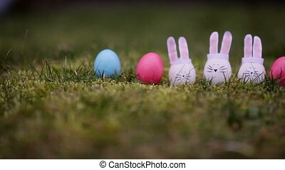 decoration for Easter. Easter bunnyes on the green grass