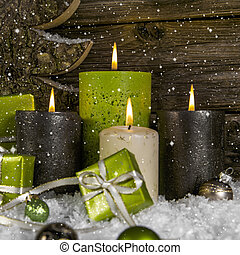 Decoration: four green and brown burning advent candles for...