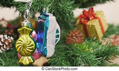 Decoration of Christmas tree bear and car toy. Pan