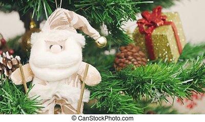 Decoration of Christmas tree Santa Claus on skis