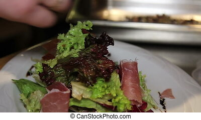 decoration of salad with jamon in the restaurant