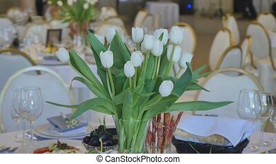 Decoration of the dining table for wedding. White tulip.