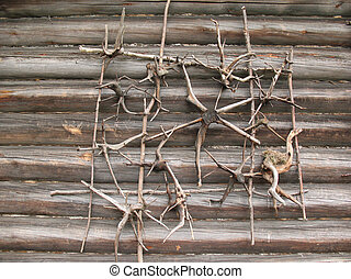 Decoration of the roots on a wooden log wall