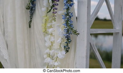 Decoration of the wedding arch with flowers