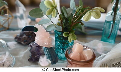 Decoration of the wedding table with rose quartz and...