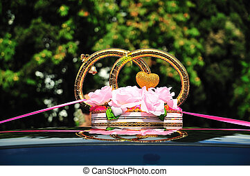 decoration of wedding car - gold rings, heart and roses on...