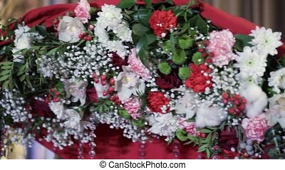 Decoration of wedding ceremony with white and red flowers