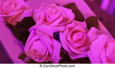 Decoration of wedding table with flowers. wedding flowers on the table. Artificial roses decorate the wedding table. bouquets on the occasion. Celebration