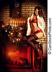 decoration santa - Beautiful young woman in sexual red...