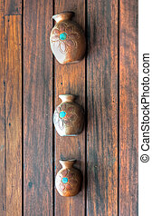 Decoration vases on a wooden wall