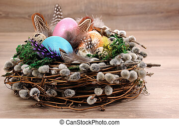 Decorations for Easter. Bird's nest with moss lined with ...