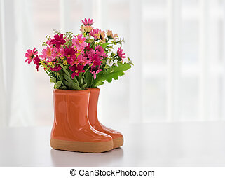 decorations for the garden. boots with flowers